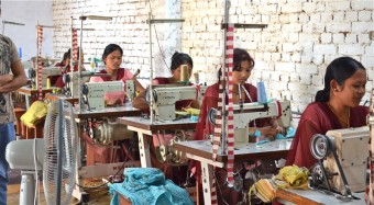 Former Kamlari at sewing class