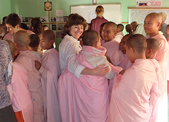 Marilyn Murphy (Thousand Oaks, CA) shares a hug with a Colorful Girls Circle participant in Burma