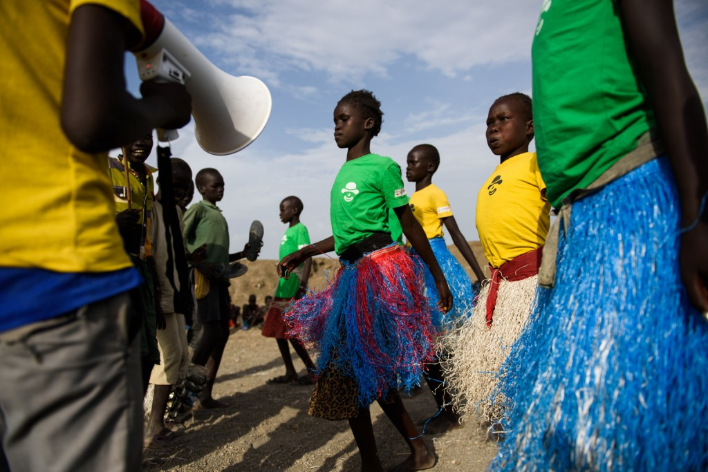 Dancers perform during an event organised at a child-friendly space run by UNICEF partner Woman Vision, in the Protection of Civilians (PoC) site, Bentiu, South Sudan, Friday 28 April 2017. Child-friendly spaces such as this one allow children to play and develop, and is an important aspect of the psycho-social wellbeing for those displaced by conflict. Six years after independence, the hopes and dreams of this fledgling nation have been shattered by armed conflict. Two million people are displaced within South Sudan's borders, and another two million have fled the country, inflicting unthinkable hardship and suffering. Established in December 2013, the Bentiu Protection of Civilians (PoC) site hosts, as of late June 2017, some 114,000 internally displaced persons. More than 70% of children in South Sudan are not receiving an education, the highest proportion of out of school children in the world. Within the PoC site, some 95% of children are enrolled at the UNICEF and partner supported primary schools. UNICEF also supports Child Friendly Spaces (CFS) where psychosocial counsellors provide help to children who have witnessed horrific violence and are suffering from trauma. By allowing children to play games and engage in a routine, children are offered a sense of normality which is lacking in their day-to-day lives.