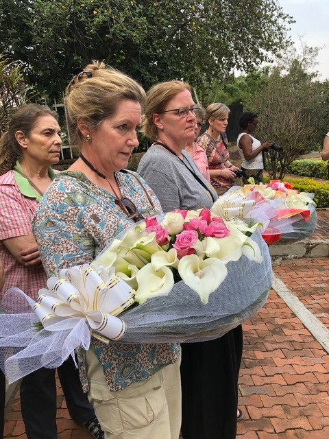 Laying flowers at the Kigali Genocide Memorial